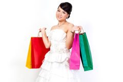 Bride with shopping bag on white background. Stock Photo