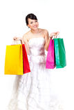 Bride with shopping bag on  white background. Royalty Free Stock Images