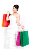 Bride is shopping the white background. Stock Photos