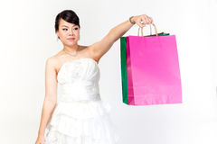 Bride is shopping the white background. Stock Image