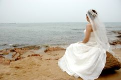 Bride on the shore Stock Photography