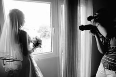 Bride Shot. Bride posing in front of the photographers Royalty Free Stock Image