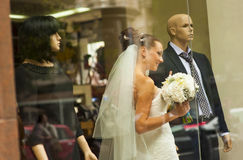 The bride in showcase. Royalty Free Stock Images