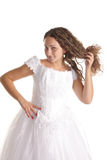 Bride showing curls. Pretty girl in a bride white dress showing curls isolated Stock Photo