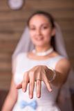 Bride showing golden wedding ring on her hand Stock Photos