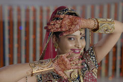Bride showing henna on her hands hands in Indian Hindu wedding Stock Image