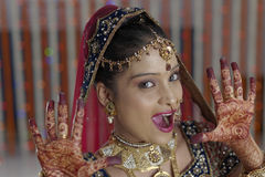 Bride showing henna on her hands hands in Indian Hindu wedding Stock Photography