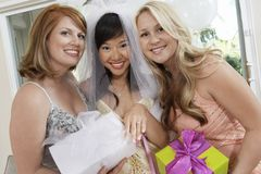 Bride Showing Her Engagement Ring With Friends Holding Gifts Royalty Free Stock Images