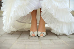 Bride Showing Her Shoes Royalty Free Stock Photo