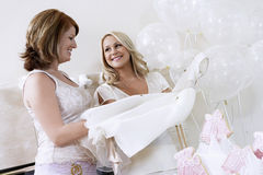 Bride Showing Off Dress At Bridal Shower Stock Photos