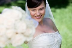 Bride Showing Off Her Flower Bouquet Stock Photo