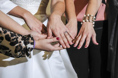 Bride showing off the wedding ring to friends Stock Images