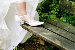 Bride showing off wedding shoes Stock Photos
