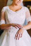 Bride shows beautiful expensive bracelet on her hand Stock Image