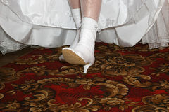 Bride shows her wedding white boots Stock Photos