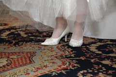 Bride shows her wedding white shoes Stock Photo