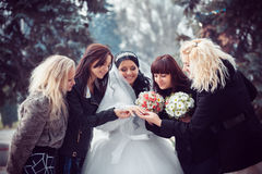 Bride shows the wedding ring to girlfriends Royalty Free Stock Image