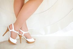 The bride shows  wedding shoes Stock Photo