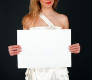 Bride shows white board Royalty Free Stock Images