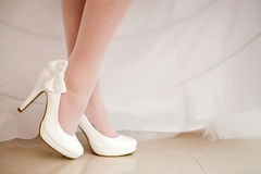 The bride shows white  shoes Stock Images