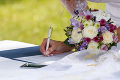 Bride signed contract Stock Photography
