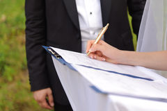 Bride Signing Certificate Royalty Free Stock Images