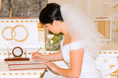 Bride signing documents Royalty Free Stock Image