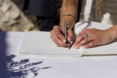 Bride signing Royalty Free Stock Photo
