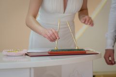 Bride signing marriage license Royalty Free Stock Photography