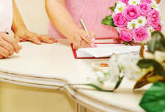 Bride signing marriage license Royalty Free Stock Images