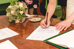 Bride signing marriage license Stock Image