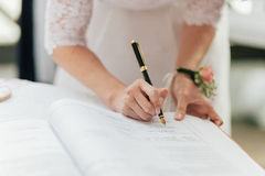 Bride Signing Marriage License Stock Photos