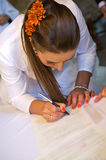 Bride signing register Royalty Free Stock Photography
