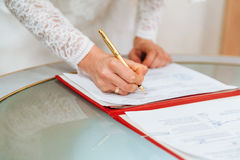 Bride signing signature on wedding certificate Stock Photography