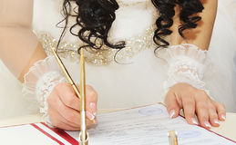 Bride signing  wedding contract Stock Image