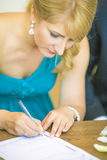 Bride Signing Wedding Contract Royalty Free Stock Photography