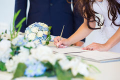 Bride signing wedding license Stock Image