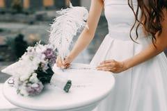 Bride signs. At her wedding stock photos