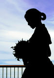Bride silhouette. Silhouette of a bride with a bouquet of flowers Royalty Free Stock Photo