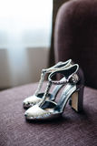 Bride silver shoes Royalty Free Stock Images