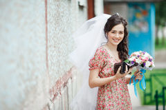The bride in a simple retro dress with floral Stock Photography