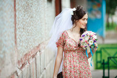 The bride in simple retro dress with floral Royalty Free Stock Photo