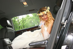 Bride sits in the car Royalty Free Stock Photography