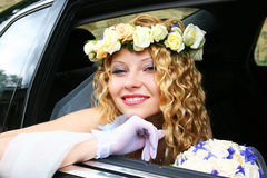 Bride sits in the car Royalty Free Stock Images