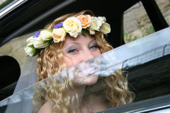 Bride sits in the car Stock Image