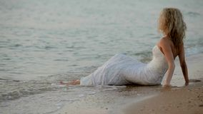 Bride Sits On The Sand Waves Washed Her Feet stock footage