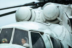 Bride sits in a white helicopter in a rainy weather Royalty Free Stock Photo