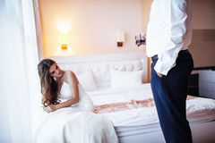 Bride sitting on the bed Royalty Free Stock Image