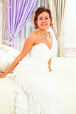 Bride on bed Stock Image