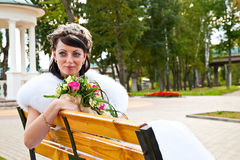 Bride is sitting on a bench Stock Photo